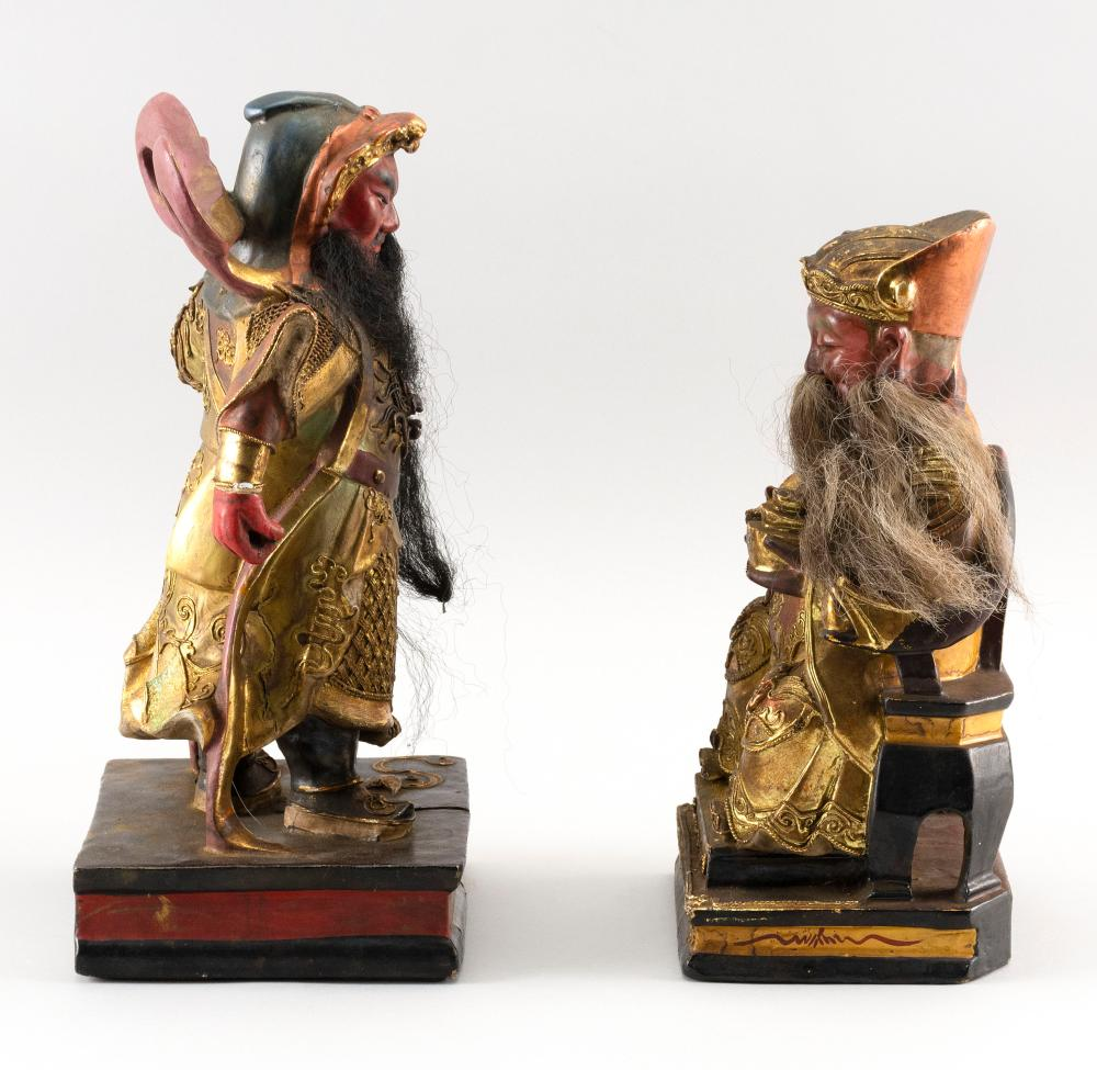 TWO CHINESE GILT AND LACQUERED CARVED WOOD GUARD AND WARRIOR FIGURES Ornately carved. Both with horsehair details. Heights 10