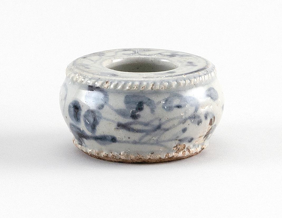 KOREAN UNDERGLAZE BLUE AND WHITE PORCELAIN BRUSH WASHER Circular, with raised rope-like rim and foot, and floral decoration. Height...