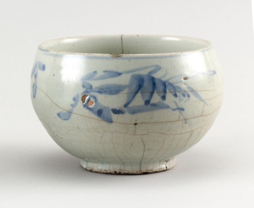 KOREAN UNDERGLAZE BLUE AND WHITE PORCELAIN BOWL Blue floral sprays about the exterior. Height 4