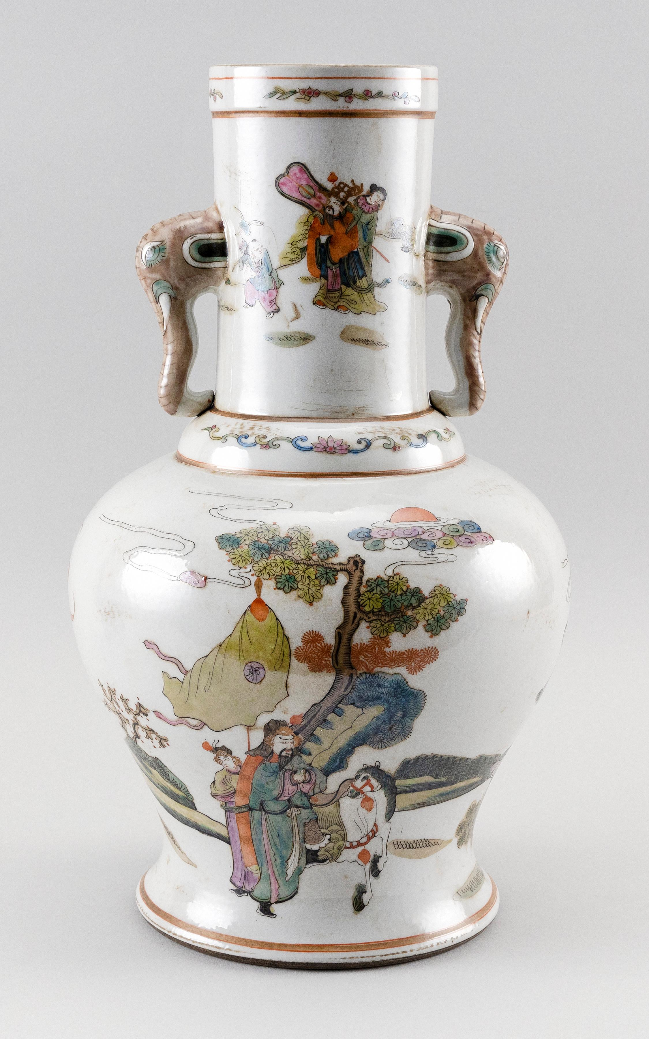 CHINESE FAMILLE VERTE PORCELAIN VASE In baluster form, with elephant's-head handles on stem and figural procession and bat decoratio..