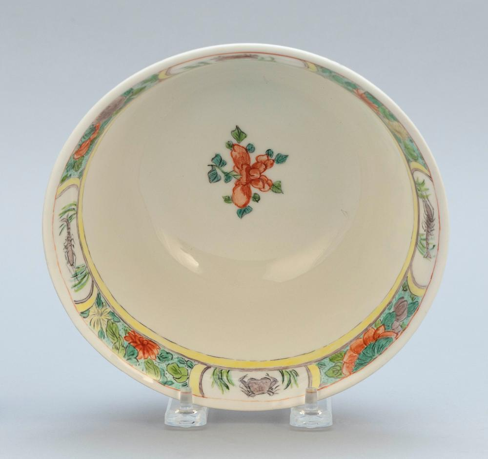 CHINESE FAMILLE VERTE PORCELAIN BOWL Exterior decoration of alternating dragon, carp and crab cartouches on a red ground. Interior w...