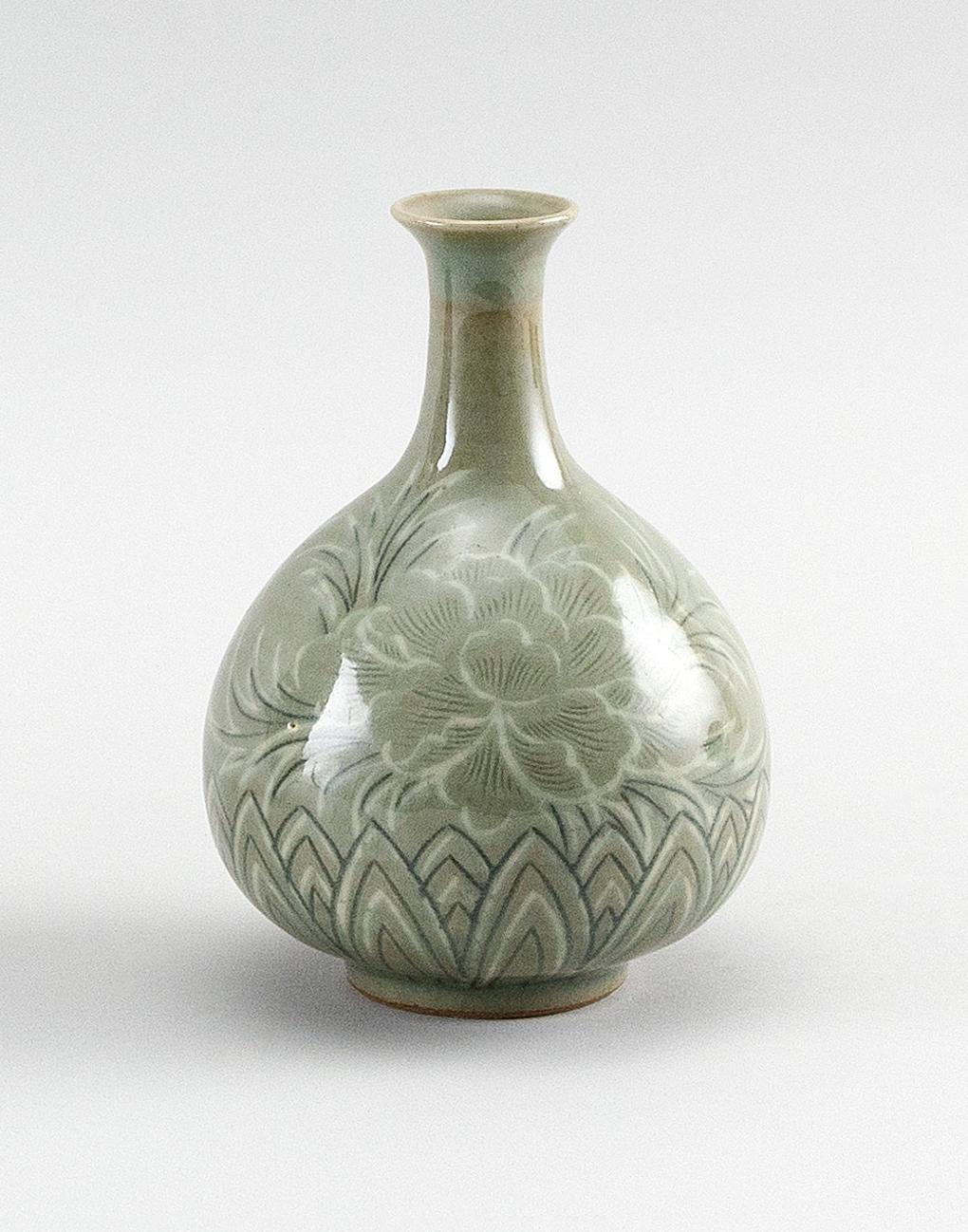 "KOREAN CELADON GLAZE BOTTLE VASE Floral and lappet decoration. Height 6.5"". Provenance: A private Florida Collection."