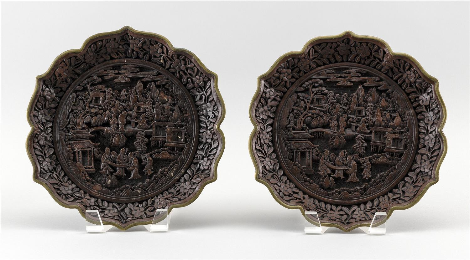 PAIR OF CHINESE DARK RED CINNABAR PLATES Scalloped edges trimmed in bronze. Central figural landscape. Six-character Qianlong mark o...