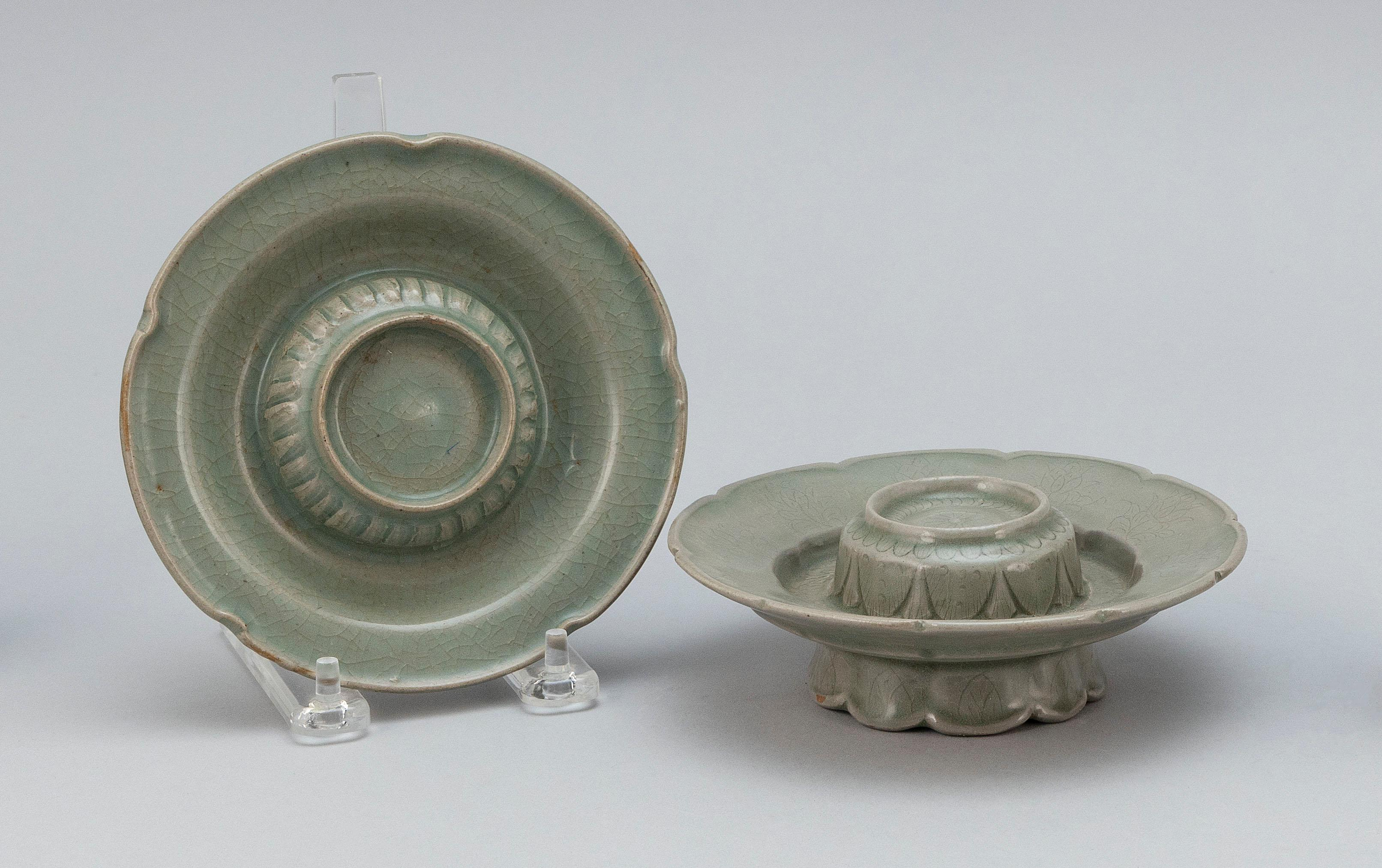 """TWO KOREAN CELADON PORCELAIN INCENSE HOLDERS In lotus flower form, with slightly raised stand. Heights 1.75"""". Diameters 6"""". Provenan..."""