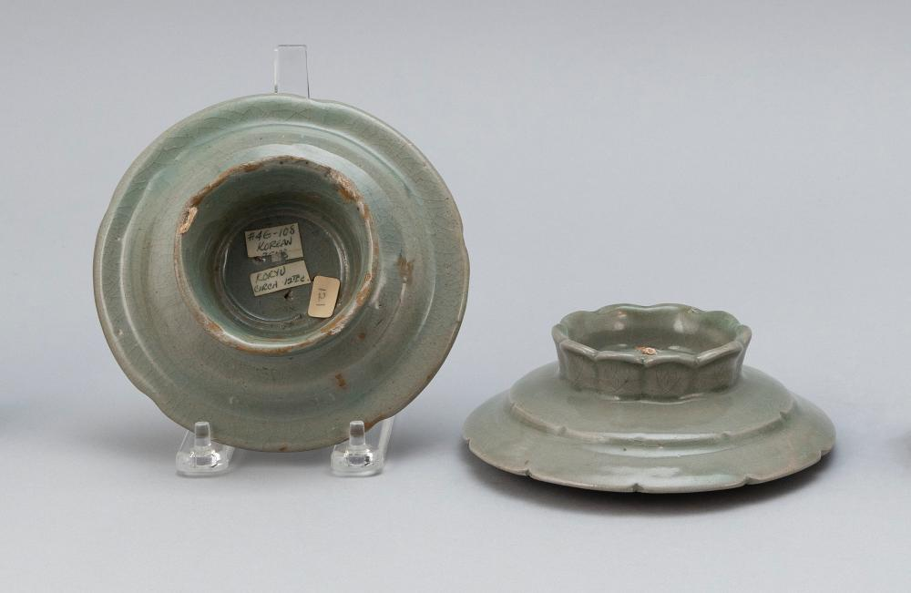 TWO KOREAN CELADON PORCELAIN INCENSE HOLDERS In lotus flower form, with slightly raised stand. Heights 1.75