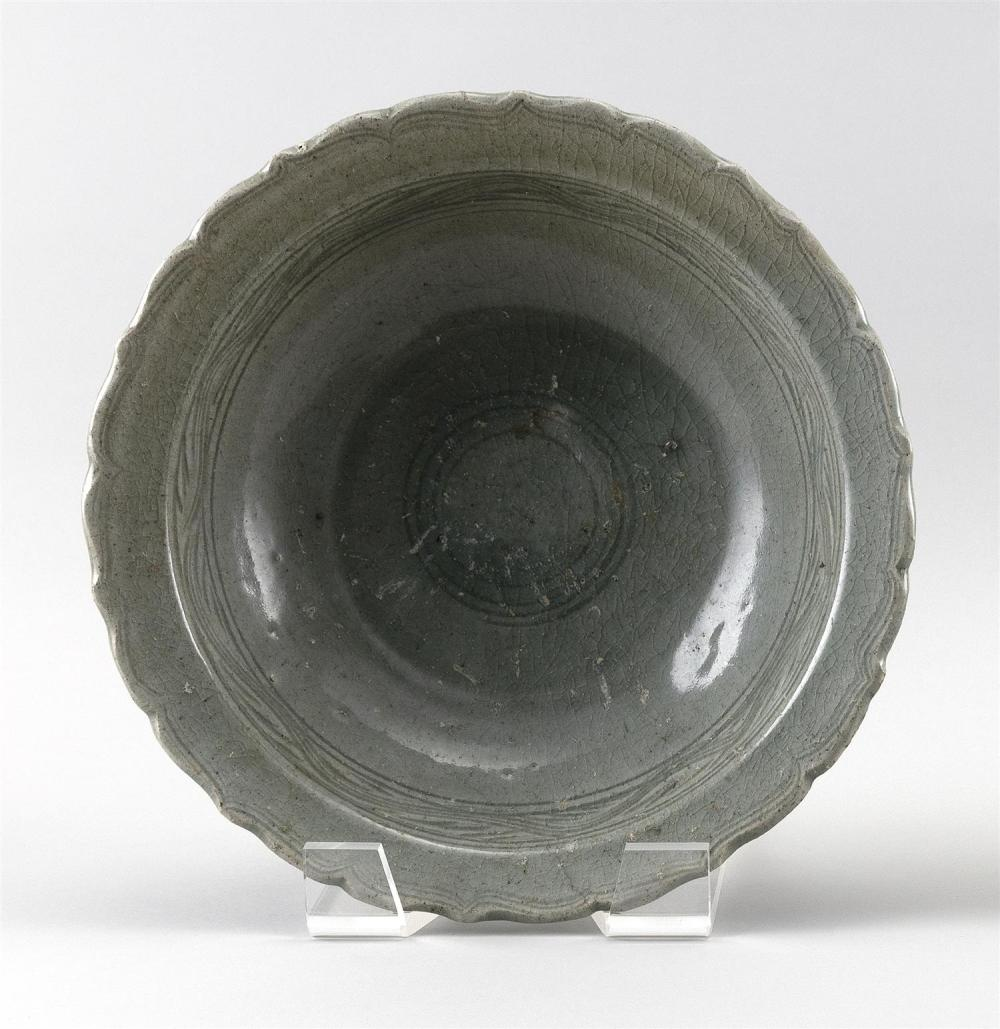 """KOREAN CELADON PORCELAIN BOWL With scalloped edge, ribbed decoration on exterior, and wave banding on interior. Height 4"""". Diameter..."""