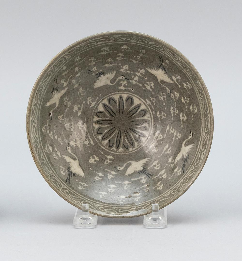 KOREAN CELADON PORCELAIN BOWL Interior decorated with cranes and clouds around a central floral medallion. Exterior decorated with f...