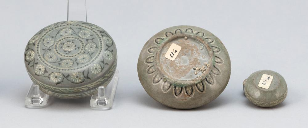 THREE PIECES OF KOREAN CELADON PORCELAIN 1) Circular covered box with floral and vine design. Diameter 3