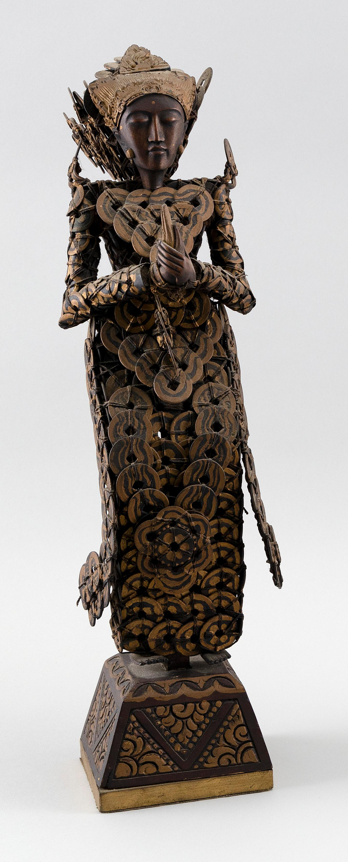 """BALINESE SANDALWOOD AND KEPENG CHINESE COIN FIGURE OF A LEGONG DANCER Standing on a carved and painted wood base. Height 18"""". Proven..."""
