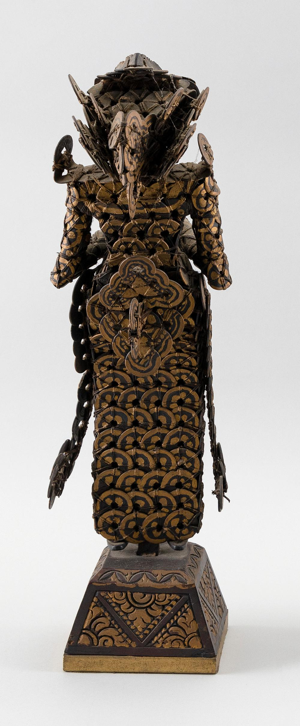 BALINESE SANDALWOOD AND KEPENG CHINESE COIN FIGURE OF A LEGONG DANCER Standing on a carved and painted wood base. Height 18