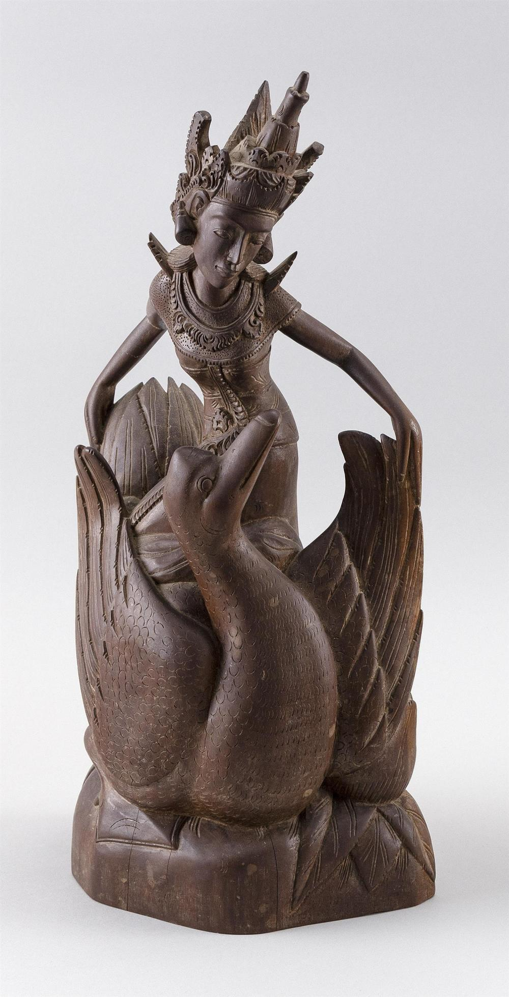"""BALINESE CARVED WOOD FIGURE OF A DANCER AND SWAN Height 16"""". Provenance: Private Cape Cod Collection."""