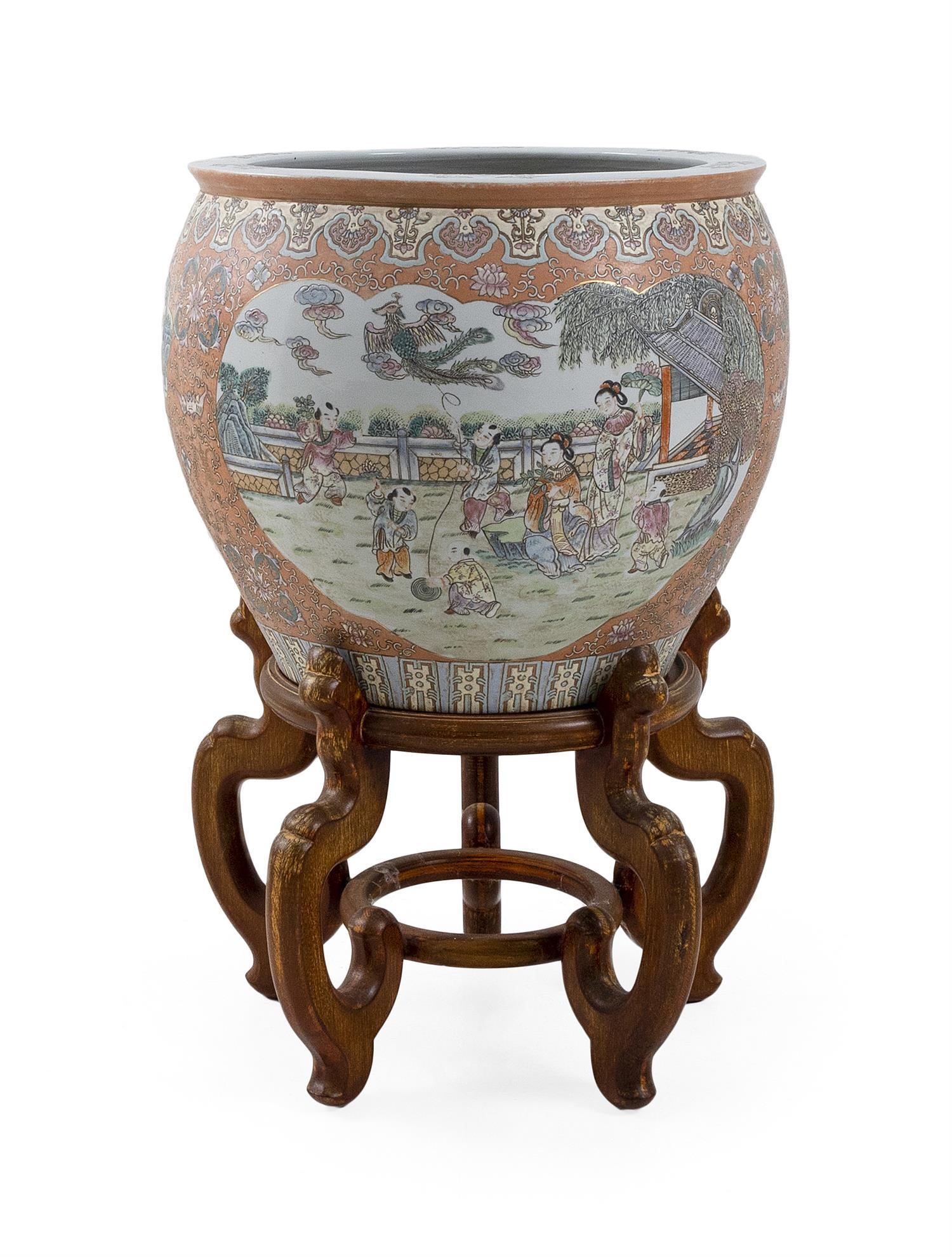 CHINESE PORCELAIN FISH BOWL Exterior with figural scenes against a peach-colored ground. Interior with goldfish and aquatic vegetati...