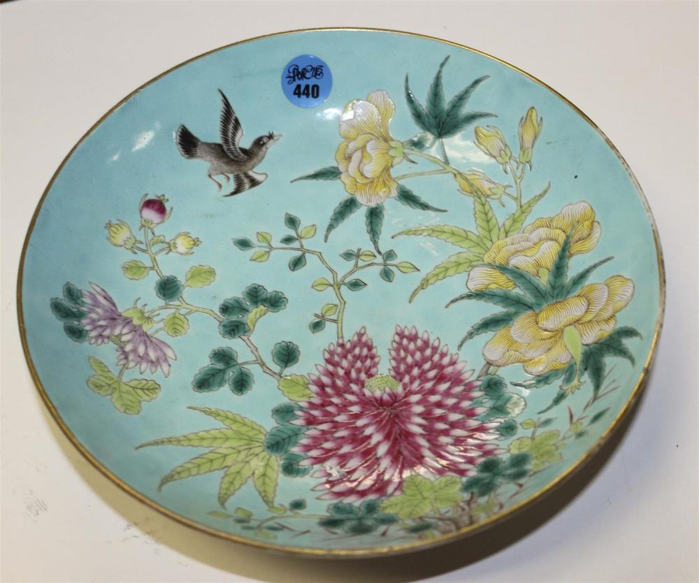 CHINESE FAMILLE ROSE PORCELAIN SHALLOW DISH Decoration of a bird amongst flowers on a turquoise blue ground. Six-character Jiajing m...