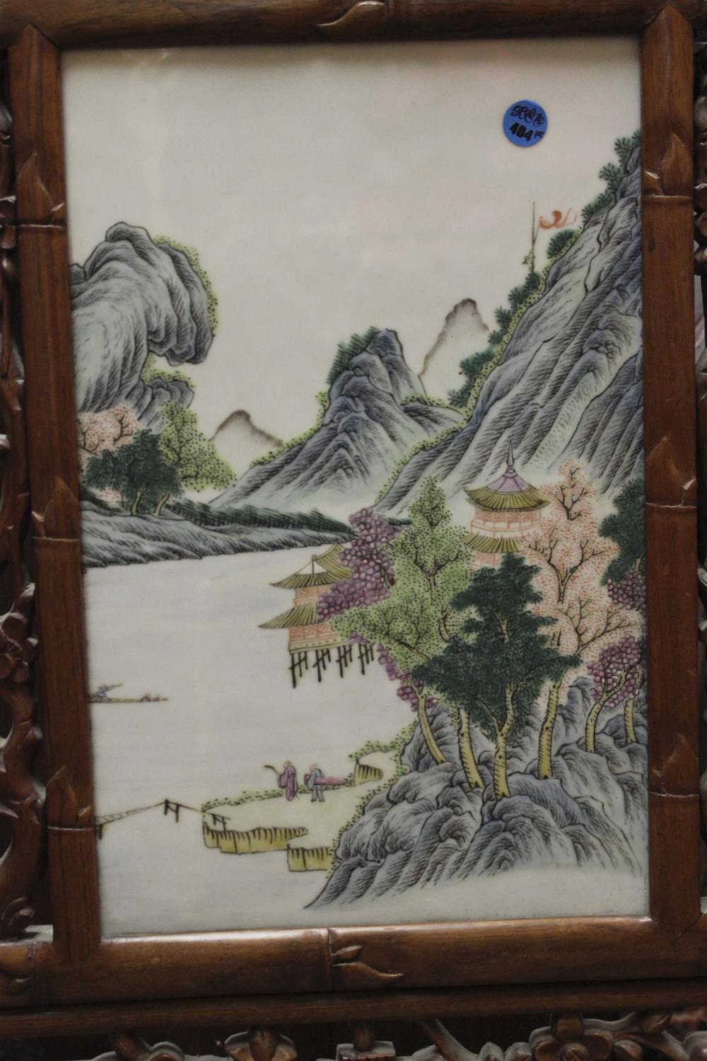 PAIR OF FRAMED CHINESE FAMILLE VERTE PORCELAIN TILES Both with finely enameled mountain river landscapes. 14