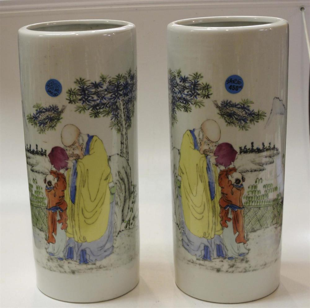 PAIR OF CHINESE FAMILLE ROSE PORCELAIN HAT STANDS Decorated with scholar's objects, vases and jardinières. Heights 11