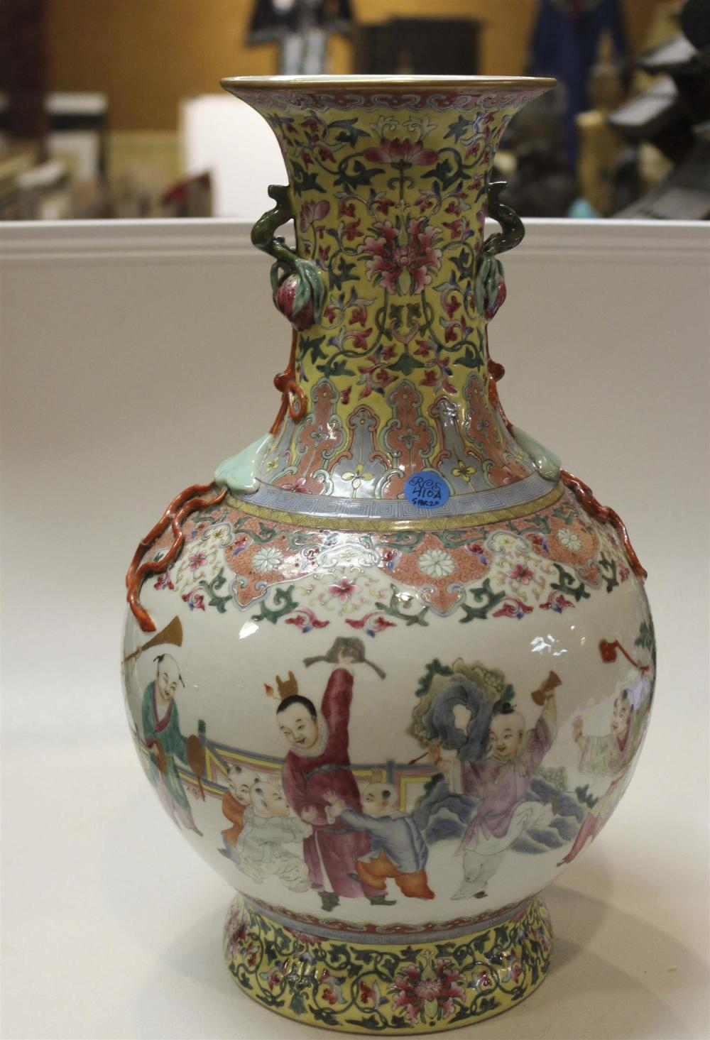 CHINESE FAMILLE ROSE PORCELAIN BALUSTER-FORM VASE Decoration of children playing in a landscape about the body. Neck and foot with l...