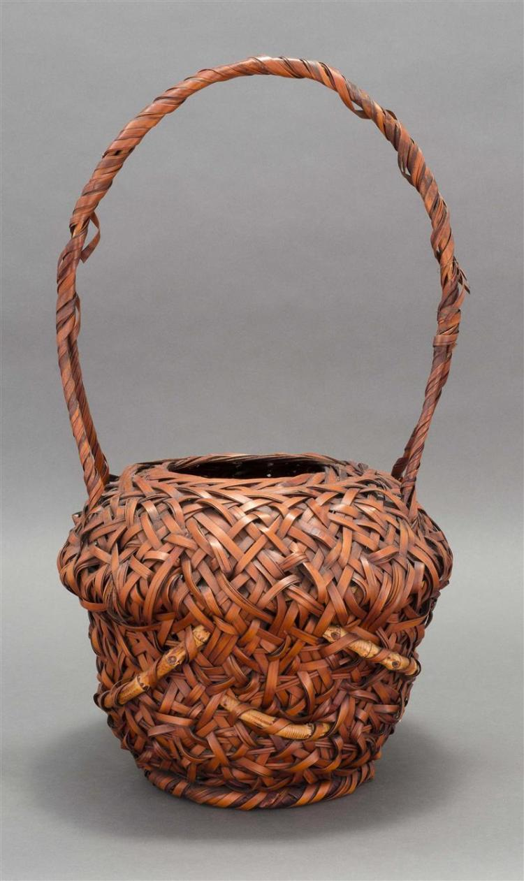 SPLINT BAMBOO IKEBANA BASKET In modified ovoid form with bamboo imbrications and entwined handle. Height 23.5