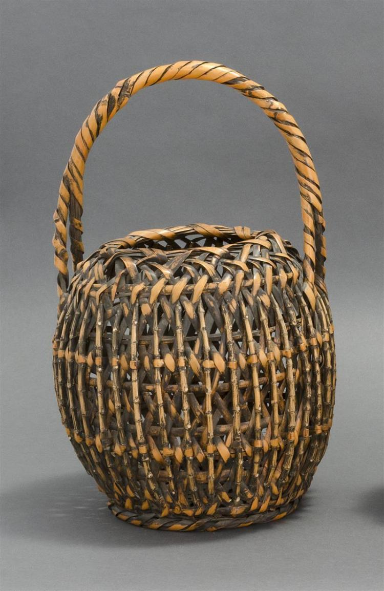 SPLINT AND BAMBOO TWIG IKEBANA BASKET In ovoid form with vertical bamboo design. Entwined handle. Height 16.5