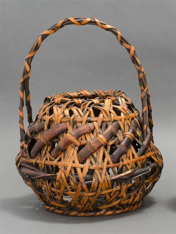 SPLINT BAMBOO IKEBANA BASKET In ovoid form with bamboo and branch imbrication. Bamboo and entwined splint handle. Height 16.5