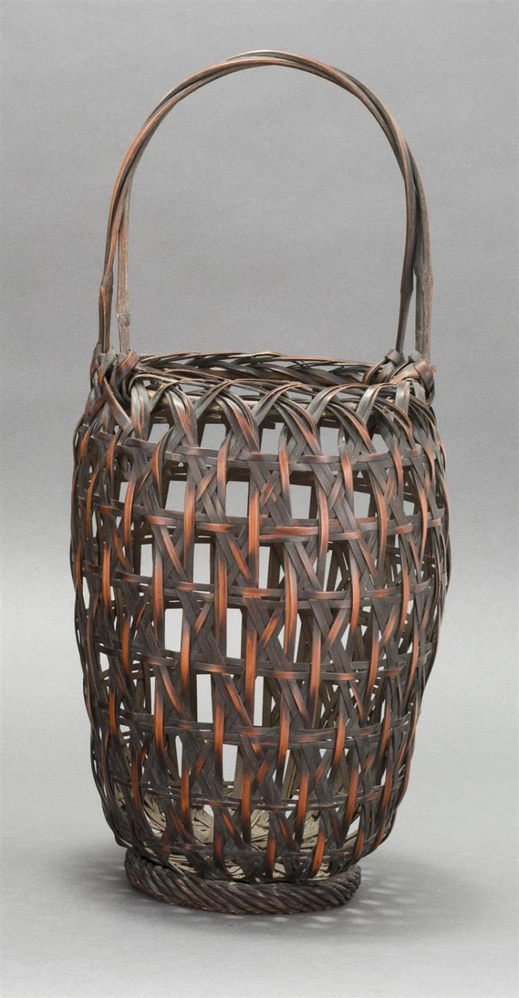 SPLINT BAMBOO IKEBANA BASKET In elongated ovoid form with openwork lattice design. Rope-work foot and woven bamboo handle. Height 18...