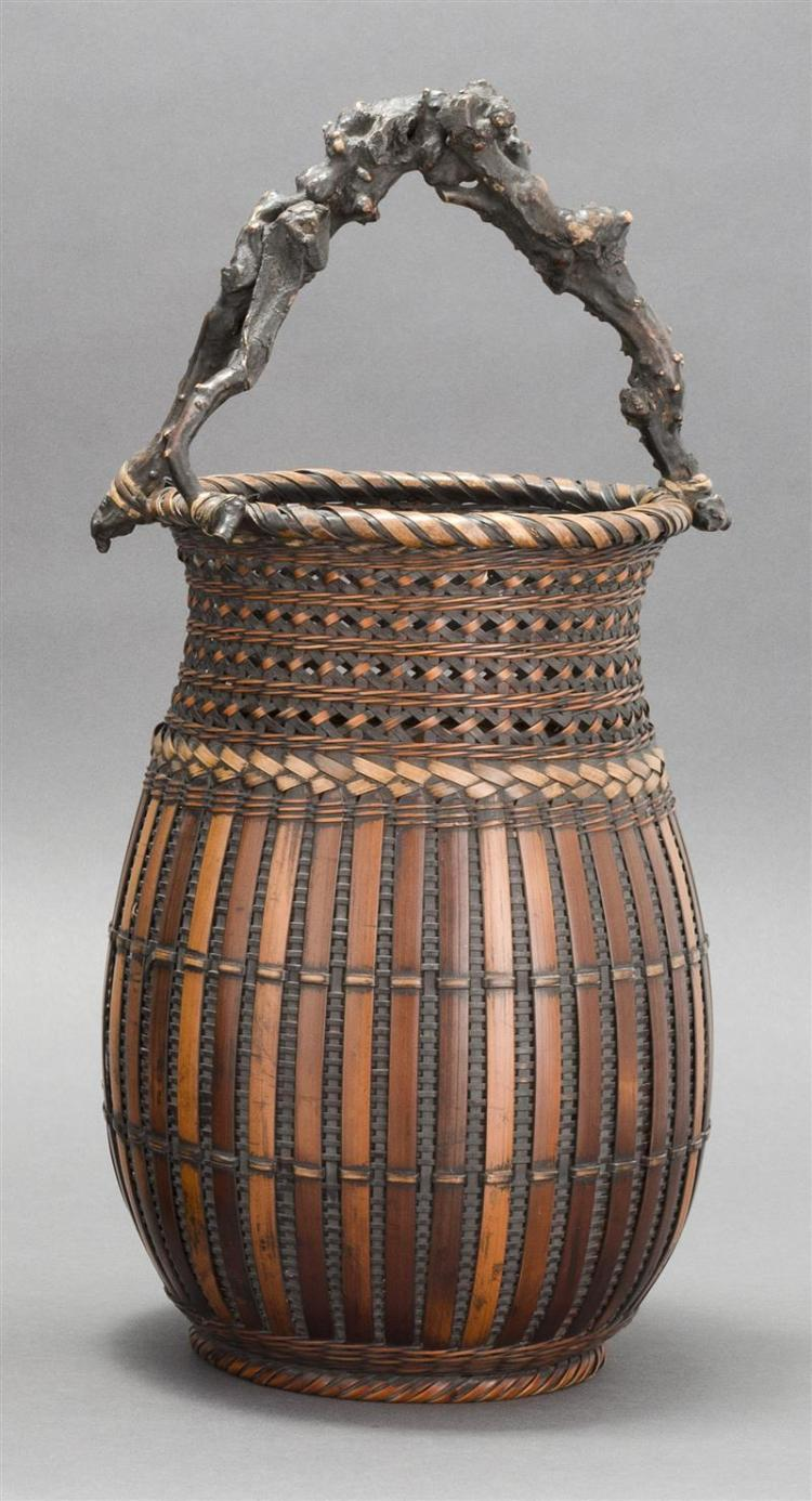 SPLINT BAMBOO IKEBANA BASKET In pear shape with lattice design neck and ribbed body. Root wood handle. Height 18