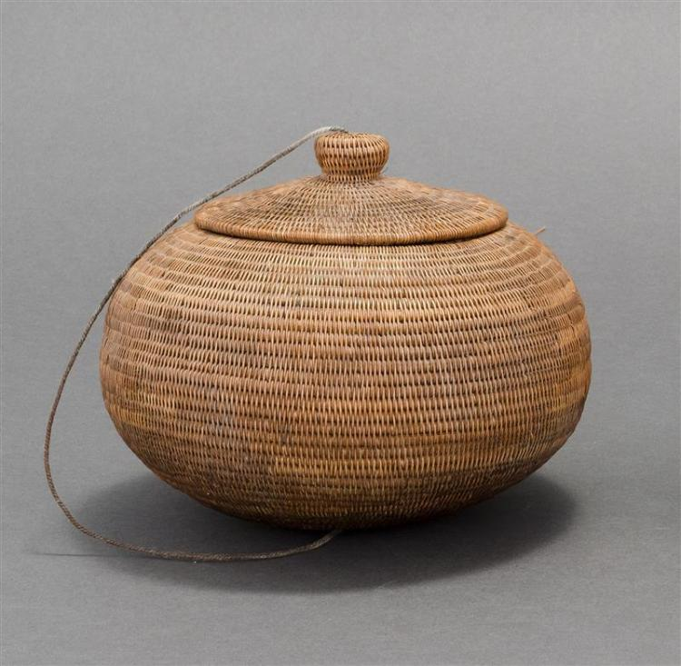 NORTHWEST COASTAL COVERED BASKET In ovoid form with string-attached cover. Diameter 6.5