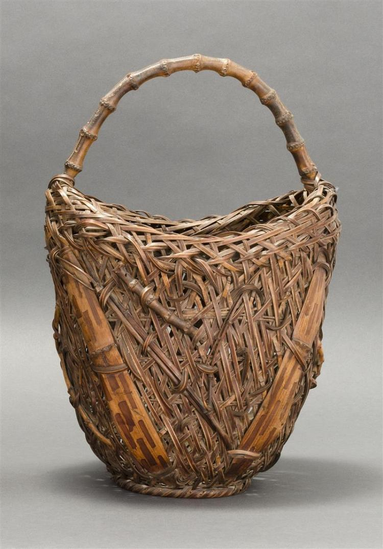 SPLINT BAMBOO IKEBANA BASKET In crescent form with bamboo imbrication. With some two-color bamboo embellishments and bent bamboo han...