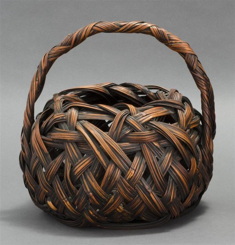 SPLINT BAMBOO IKEBANA BASKET In ovoid form with entwined design and loop handle. Height 12