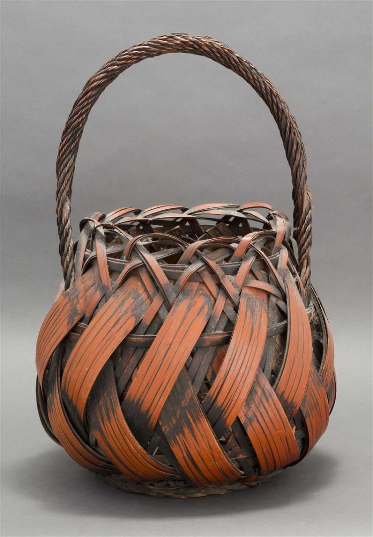 SPLINT BAMBOO IKEBANA BASKET In ovoid form with rope handle. Height 23