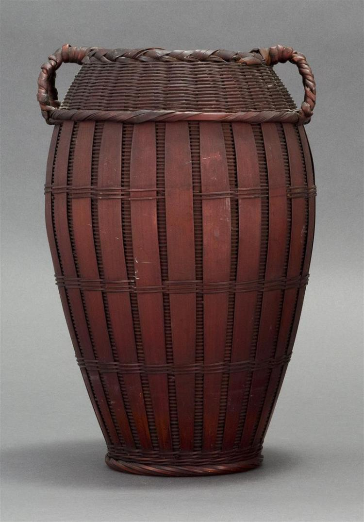 SPLINT BAMBOO IKEBANA BASKET In seed form with vertical striping and two handles at shoulder. Signed. Height 12