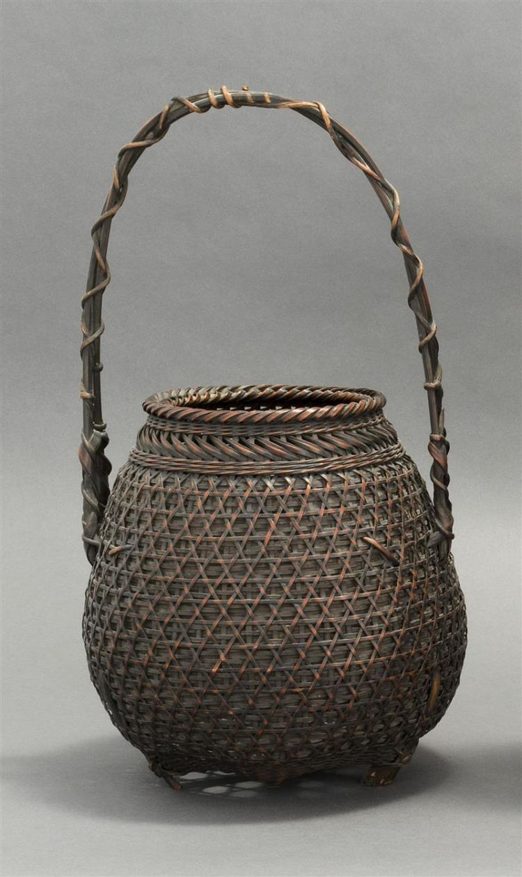 SPLINT BAMBOO IKEBANA BASKET In pear shape with overall even lattice design. Bamboo and vine handle. Height 17.3