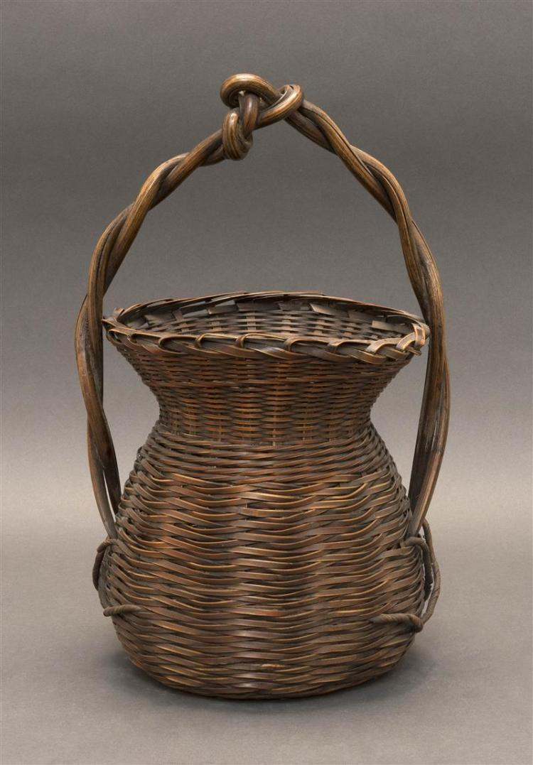 SPLINT BAMBOO IKEBANA BASKET In pear shape with flared rim. Entwined vine handle. Height 14.5