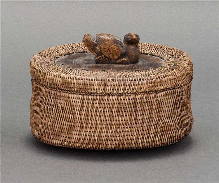 NORTHWEST COASTAL COVERED BASKET In oval form with bird finial. Length 7.5