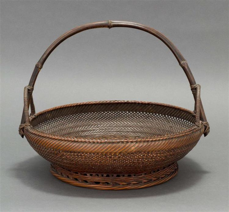 SPLINT BAMBOO IKEBANA BASKET In bowl form with herringbone splinting, flared lattice-design foot, and bent bamboo handle. Interior w...
