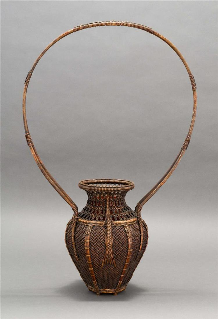 SPLINT BAMBOO IKEBANA BASKET In temple jar form with hexagonal sides, openwork top, and dramatic loop handle. Height 29