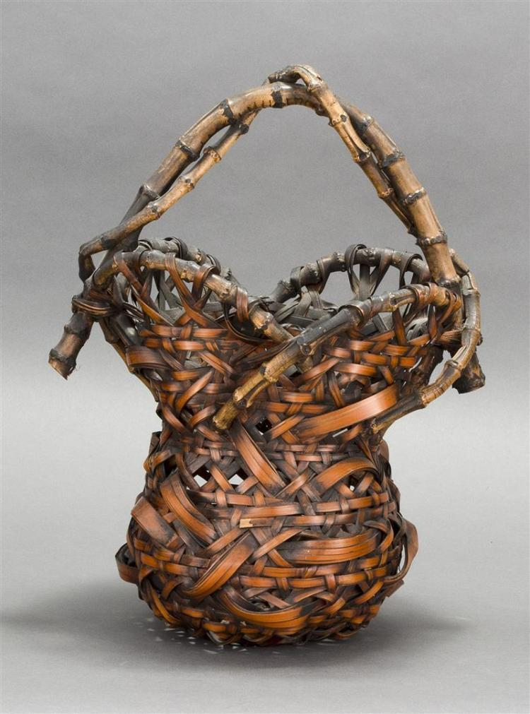 SPLINT BAMBOO IKEBANA BASKET In hourglass form with openwork at flower-form rim and entwined handle. Height 16