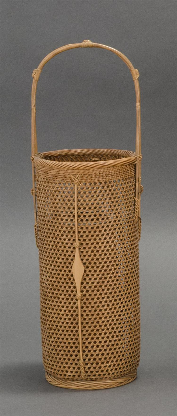 SPLINT BAMBOO IKEBANA BASKET In cylinder form with bamboo handle and embellishments. Height 16