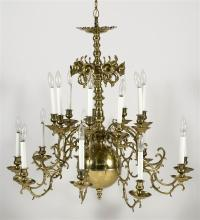 BRASS EIGHTEEN-SOCLE CHANDELIER Converted to electricity by Mr. Rosenthal. Height 33