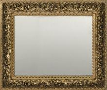 TYROLEAN GILT FRAME In Rococo style with acanthus leaf motif. Mounted with a mirror. Aperture 39.5
