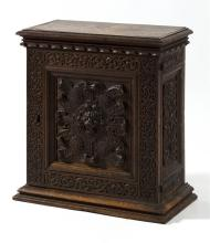 BLACK WALNUT NINE-DRAWER SPICE CABINET With lion's-head and rose-carved door. Dated 1634 on interior of door. Molded top and foot. H..