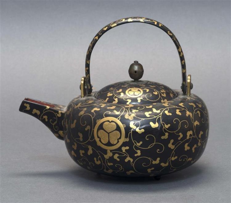 BLACK AND GOLD LACQUER WINE POT (CHOSHI) In ovoid form with Tokugawa mon and karakusa design. Red lacquer interior. Length 7.25