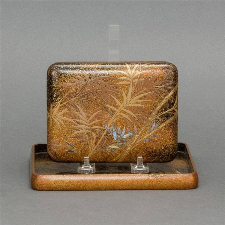 BLACK AND GOLD LACQUER COVERED BOX WITH UNDERTRAY In a bamboo and chrysanthemum design. Signed. Length of box 5.25