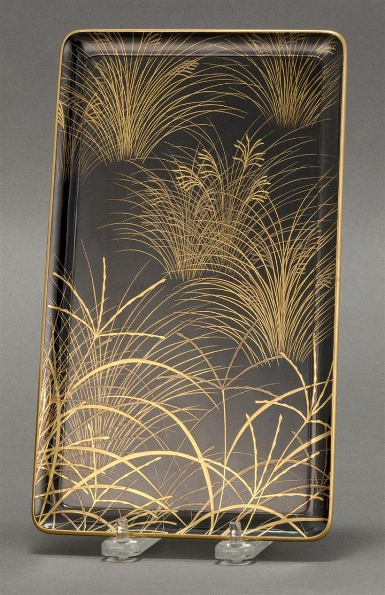 BLACK AND GOLD LACQUER FOOTED TRAY In rectangular form with grasses design on a black ground. Nashiji underside. Length 9.75