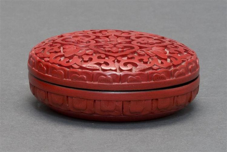 CINNABAR SEAL PASTE BOX In circular form with a floral design. Diameter 3