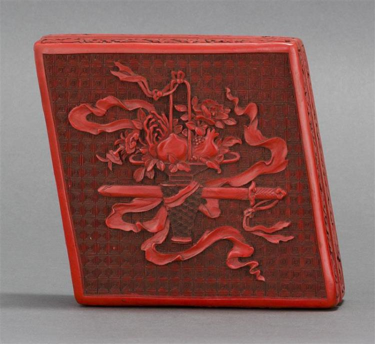 CINNABAR BOX In diamond form with peach basket and sword design. Length 8.25