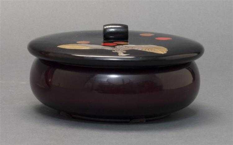 BLACK, RED, AND SILVER LACQUER BOX In circular form with plum blossom design. Diameter 6.6