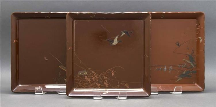 THREE BROWN LACQUER TRAYS With butterfly borders surrounding designs of fishermen, birds, and marsh grasses. 14