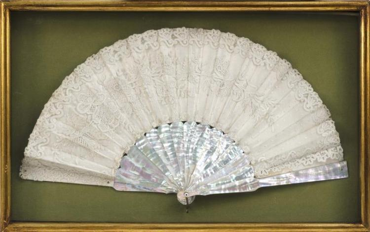 MOTHER-OF-PEARL AND LACEWORK FOLDING FAN In floral design. Length 19