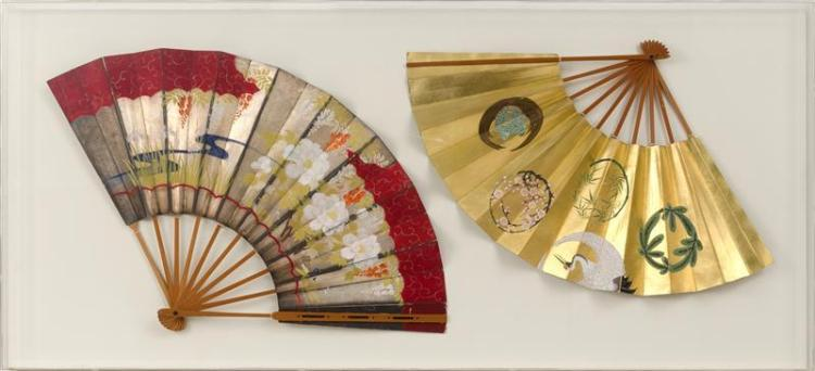 TWO PAINTED PAPER FOLDING FANS One with crane and tortoise design on a gold ground. One with floral design on a red ground. Lengths...