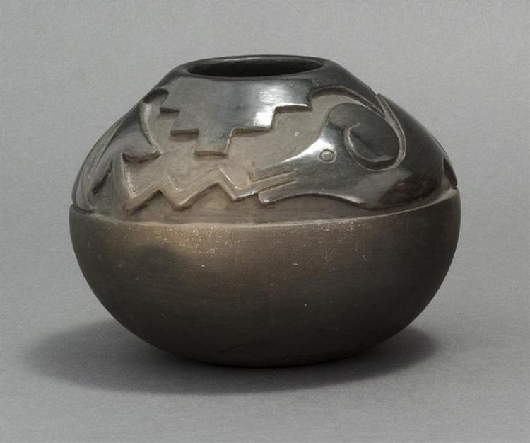 SAN ILDEFONSO PUEBLO BLACK-ON-BLACK POTTERY BOWL By Adelphia Gonzales Martinez (b. 1935). In ovoid form with a raised serpent design...